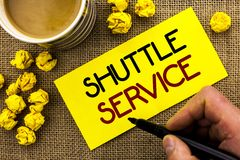 Text sign showing Shuttle Service. Conceptual photo Transportation Offer Vacational Travel Tourism Vehicle written on Sticky Note. Text sign showing Shuttle Royalty Free Stock Image