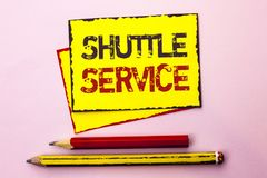 Text sign showing Shuttle Service. Conceptual photo Transportation Offer Vacational Travel Tourism Vehicle written on Yellow Stick. Text sign showing Shuttle Royalty Free Stock Image