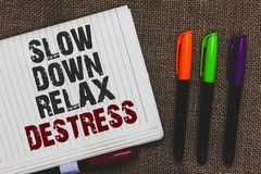 Text sign showing Slow Down Relax Destress. Conceptual photo calming bring happiness and put you in good mood Open notebook page j. Ute background colorful Royalty Free Stock Image