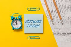 Text sign showing Software Release. Conceptual photo sum of stages of development and maturity for program Notepad clips. Text sign showing Software Release stock image
