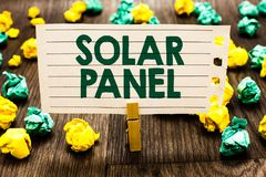 Text sign showing Solar Panel. Conceptual photo designed to absorb suns rays source of energy generating Clothespin holding notebo. Ok paper crumpled papers royalty free stock image