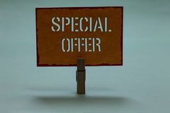 Text sign showing Special Offer. Conceptual photo Selling at a lower or discounted price Bargain with Freebies Clothespin holding. Orange paper important stock image