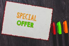 Text sign showing Special Offer. Conceptual photo Selling at a lower or discounted price Bargain with Freebies White paper red bor. Ders colorful markers wooden stock photography