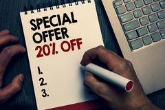 Text sign showing Special Offer 20 Off. Conceptual photo Discounts promotion Sales Retail Marketing Offer Written words. And number on notepad man hold marker royalty free stock image