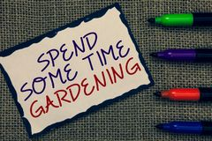 Text sign showing Spend Some Time Gardening. Conceptual photo Relax planting flowers fruits vegetables Natural Blue royalty free stock photography