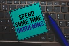 Text sign showing Spend Some Time Gardening. Conceptual photo Relax planting flowers fruits vegetables Natural Huge button with co. Mputer keyboard black lined royalty free stock photography