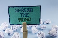 Text sign showing Spread The Word. Conceptual photo Run advertisements to increase store sales many fold written on Sticky Note Pa. Text sign showing Spread The stock image
