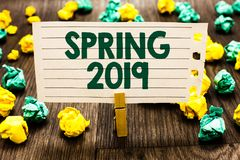 Text sign showing Spring 2019. Conceptual photo time of year where flowers rise following winter season Clothespin holding noteboo. K paper crumpled papers royalty free stock images