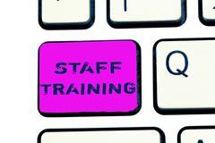 Text sign showing Staff Training. Conceptual photo A program that helps employees to learn specific knowledge.  Stock Photography