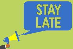 Text sign showing Stay Late. Conceptual photo A routine in which a person goes to somewhere out of time Man holding megaphone loud. Speaker speech bubble message stock images