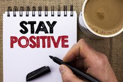 Text sign showing Stay Positive. Conceptual photo Be Optimistic Motivated Good Attitude Inspired Hopeful written by Man Holding Ma. Rker Notebook Book the jute Royalty Free Stock Images
