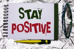 Text sign showing Stay Positive. Conceptual photo Be Optimistic Motivated Good Attitude Inspired Hopeful written on Notebook Book. Text sign showing Stay Stock Photo