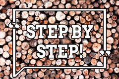 Text sign showing Step By Step. Conceptual photo Slow progress Road to success Direction development Growth Wooden. Background vintage wood wild message ideas stock photography