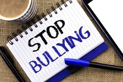 Text sign showing Stop Bullying. Conceptual photo Do not continue Abuse Harassment Aggression Assault Scaring written on Notebook. Text sign showing Stop Royalty Free Stock Photos