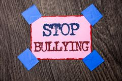 Text sign showing Stop Bullying. Conceptual photo Do not continue Abuse Harassment Aggression Assault Scaring written on Pink Stic. Text sign showing Stop Stock Photo