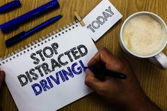 Text sign showing Stop Distracted Driving. Conceptual photo asking to be careful behind wheel drive slowly Man holding marker note. Book clothespin reminder stock image