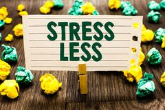 Text sign showing Stress Less. Conceptual photo Stay away from problems Go out Unwind Meditate Indulge Oneself Clothespin holding. Notebook paper crumpled royalty free stock photography