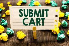 Text sign showing Submit Cart. Conceptual photo Sending shopping list of online items Proceed checkout Clothespin holding notebook. Paper crumpled papers royalty free stock photography