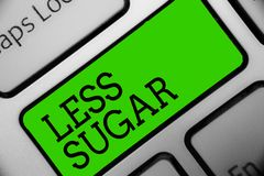 Text sign showing Less Sugar. Conceptual photo Lower volume of sweetness in any food or drink that we eat Keyboard green key Inten. Tion create computer Stock Photography