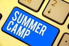Text sign showing Summer Camp. Conceptual photo Supervised program for kids and teenagers during summertime. Keyboard blue key Int. Ention create computer stock photo