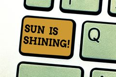 Text sign showing Sun Is Shining. Conceptual photo Beautiful sunshine Enjoying hot summer days Natural landscape. Keyboard key Intention to create computer stock photos