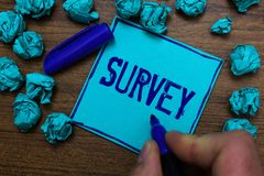 Text sign showing Survey. Conceptual photo Questioning group of people to gather opinion on a particular subject Cyan paper object. Thoughts crumpled papers royalty free stock image