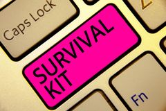 Text sign showing Survival Kit. Conceptual photo Emergency Equipment Collection of items to help someone Keyboard pink key Intenti Royalty Free Stock Photo