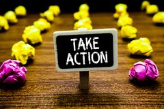 Text sign showing Take Action. Conceptual photo advices someone to do something or reaction right now Blackboard crumpled papers s. Everal tries mistake not royalty free stock image