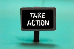 Text sign showing Take Action. Conceptual photo advices someone to do something or reaction right now Blackboard green background. Important message ideas stock image