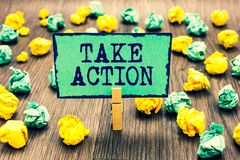 Text sign showing Take Action. Conceptual photo advices someone to do something or reaction right now Clothespin holding green not. E paper crumpled papers royalty free stock photo