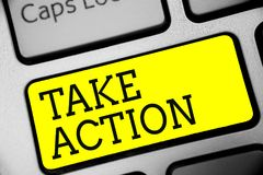 Text sign showing Take Action. Conceptual photo advices someone to do something or reaction right now Keyboard yellow key Intentio. N create computer computing royalty free stock image