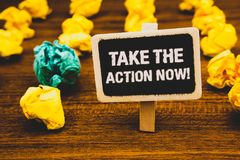 Text sign showing Take The Action Now Motivational Call. Conceptual photo Act Start Promptly Immediate Instantly Blackboard with l. Etters wooden floor blurry stock photos
