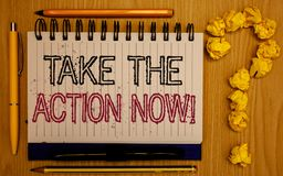 Text sign showing Take The Action Now Motivational Call. Conceptual photo Act Start Promptly Immediate Instantly Notepad with outl. Ine text pen pencil woody stock photos