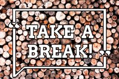 Text sign showing Take A Break. Conceptual photo Resting Stop doing something recreation time get out of work Wooden royalty free stock image