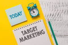 Text sign showing Target Marketing. Conceptual photo Audience goal Chosen clients customers Advertising Spiral notepad stock image