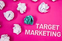 Text sign showing Target Marketing. Conceptual photo Market Segmentation Audience Targeting Customer Selection Text Words pink bac. Kground crumbled paper notes royalty free stock photo
