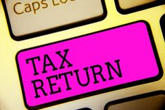 Text sign showing Tax Return. Conceptual photo which taxpayer makes annual statement of income circumstances Keyboard purple key I. Ntention create computer royalty free stock photo