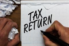 Text sign showing Tax Return. Conceptual photo which taxpayer makes annual statement of income circumstances Man holding marker no. Tebook crumpled papers ripped stock image