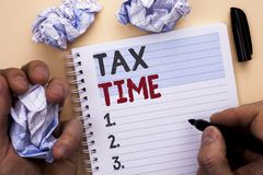 Text sign showing Tax Time. Conceptual photo Taxation Deadline Finance Pay Accounting Payment Income Revenue written by Man on Not. Text sign showing Tax Time stock photography