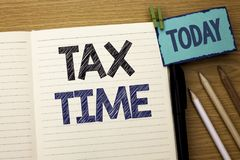 Text sign showing Tax Time. Conceptual photo Taxation Deadline Finance Pay Accounting Payment Income Revenue written on Notebook B. Text sign showing Tax Time stock image