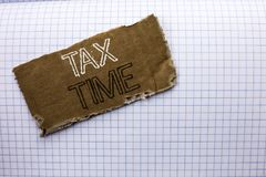 Text sign showing Tax Time. Conceptual photo Taxation Deadline Finance Pay Accounting Payment Income Revenue written on tear Cardb. Text sign showing Tax Time Royalty Free Stock Photo