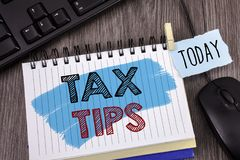 Text sign showing Tax Tips. Conceptual photo Help Ideas for taxation Increasing Earnings Reduction on expenses Concept For Informa. Text sign showing Tax Tips Royalty Free Stock Photography