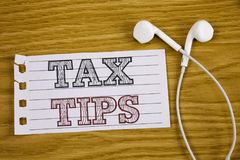 Text sign showing Tax Tips. Conceptual photo Help Ideas for taxation Increasing Earnings Reduction on expenses Concept For Informa. Text sign showing Tax Tips royalty free stock images