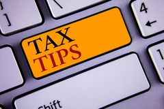 Text sign showing Tax Tips. Conceptual photo Help Ideas for taxation Increasing Earnings Reduction on expenses Concept For Informa. Text sign showing Tax Tips royalty free stock photo