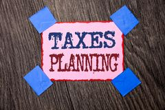 Text sign showing Taxes Planning. Conceptual photo Financial Planification Taxation Business Payments Prepared written on Pink Sti. Text sign showing Taxes Stock Photos