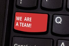 Text sign showing We Are A Team. Conceptual photo Work together to accomplish a common vision or goals Keyboard key. Intention to create computer message stock photography