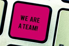 Text sign showing We Are A Team. Conceptual photo Work together to accomplish a common vision or goals Keyboard key. Intention to create computer message royalty free stock image