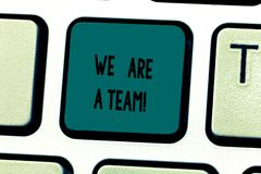 Text sign showing We Are A Team. Conceptual photo Work together to accomplish a common vision or goals Keyboard key. Intention to create computer message stock images