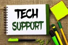 Text sign showing Tech Support. Conceptual photo Help given by technician Online or Call Center Customer Service written on Notebo. Text sign showing Tech Stock Photo