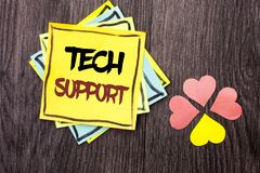Text sign showing Tech Support. Conceptual photo Help given by technician Online or Call Center Customer Service written on Stacke. Text sign showing Tech Stock Image